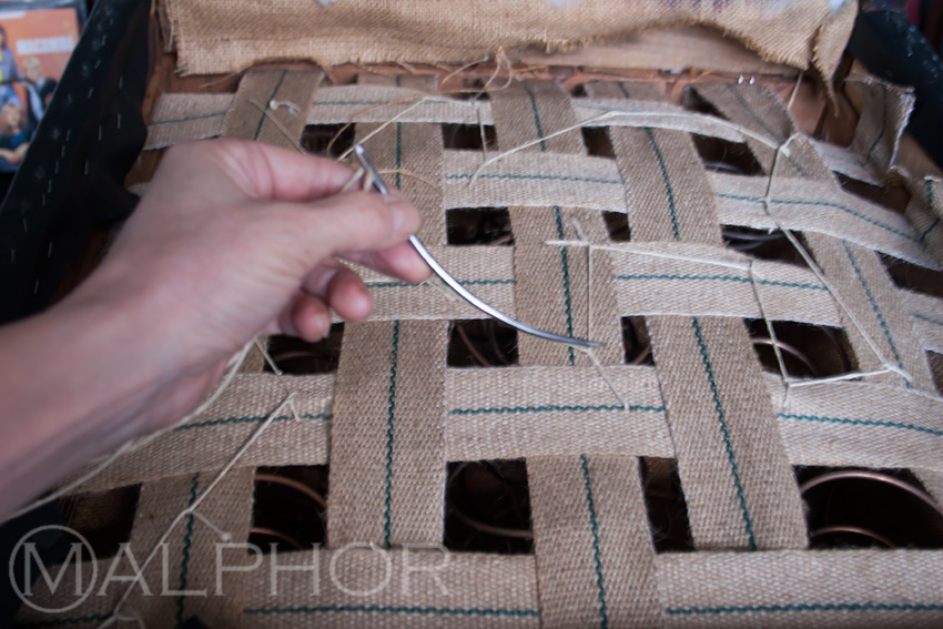Lashing The Spings Onto New Webbing